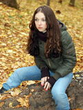 Girl in the forest. Teenage girl in the autumn forest Stock Photo