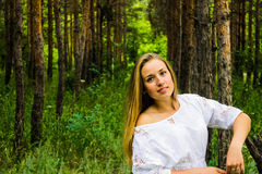Girl in the forest Stock Images
