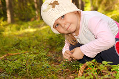 Girl in the forest, collecting berries Royalty Free Stock Photo