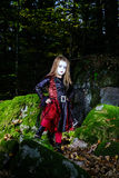 Girl in the forest dressed Halloween witch costume Stock Images