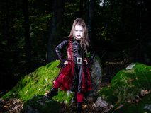 Girl in the forest dressed Halloween witch costume Stock Photos
