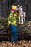 Girl in the forest with her husky dog. Beautiful girl in the woods with a dog Husky breed. Autumn Stock Photo