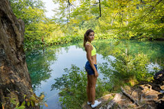 Girl by the forest lake Royalty Free Stock Images