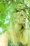 Girl in forest Stock Images