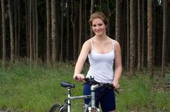 Girl forest with mountain bike Royalty Free Stock Photography