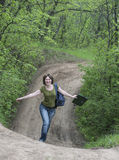 Girl on a forest road Stock Photos