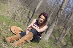 Girl in forest shooting. Girl in wood , relax and shooting Stock Images
