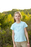 Girl in the forest. Girl standing on the path in the summer forest Royalty Free Stock Photography