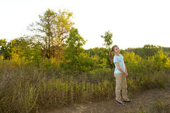Girl in the forest. Girl standing on the path in the summer forest Stock Images