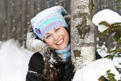 Girl in the forest in winter. A portrait of a beautiful happy girls in the forest in winter Stock Photography