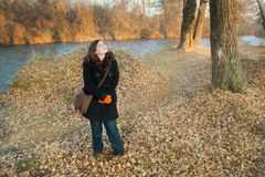 Girl in forest. Young girl in autumn forest with river Nisava, Nis-Serbia Royalty Free Stock Images