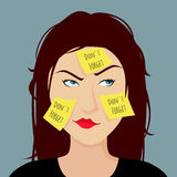 Girl forgetful stuck a yellow sticker on face. Royalty Free Stock Photo