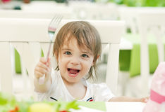 Girl with fork Stock Image
