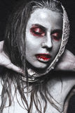 Girl in form of zombies, Halloween corpse with blood on his lips. Image for a horror film. Royalty Free Stock Photography