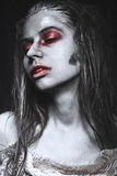 Girl in form of zombies, Halloween corpse with blood on his lips. Image for a horror film. Royalty Free Stock Images