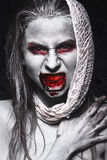 Girl in form of zombies, Halloween corpse with blood on his lips. Image for a horror film. Girl in the form of zombies, Halloween corpse with blood on his lips Royalty Free Stock Images