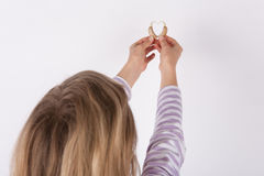 Girl forming a heart shape from hearing aids royalty free stock photos