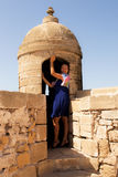 Girl in a fortress. Little trip to Essaouira. Morocco stock photos