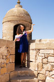 Girl in a fortress. Little trip to Essaouira. Morocco royalty free stock photo
