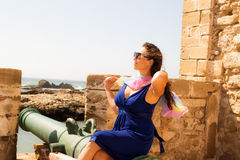 Girl in a fortress. Little trip to Essaouira. Morocco stock photo