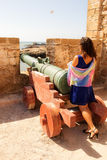 Girl in a fortress. Little trip to Essaouira. Morocco royalty free stock photos