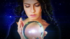 Girl with fortune telling ball against  star sky. stock video