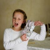 Girl with Afikoman is a half piece of matzah which is broken of the Passover Seder. royalty free stock photos