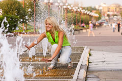 Girl about fountain Royalty Free Stock Image