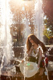 Girl in a fountain Stock Photos