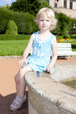 Girl on fountain Royalty Free Stock Photo