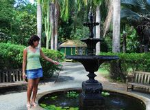 The Girl By The Fountain Stock Photo