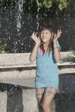Girl in a fountain Royalty Free Stock Photography