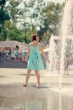 Girl at the fountain Royalty Free Stock Photography