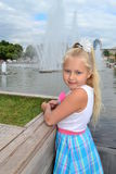 Girl at the fountain Stock Photography
