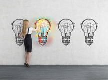 Girl and four light bulbs Royalty Free Stock Photos