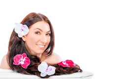 Girl with four orchids on hair Stock Image