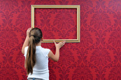 Girl with frame Royalty Free Stock Photos