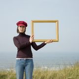 Girl with frame royalty free stock photo