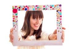 Girl in frame. Beautiful girl in frame posing.Focus in frame Royalty Free Stock Photo