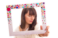 Girl in frame. Beautiful girl dreaming a dream. Focus on frame Royalty Free Stock Photo
