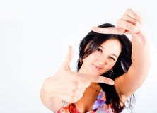 Girl with frame gesture. Focus on fingers Royalty Free Stock Photos