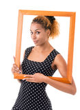 The girl with the frame of the picture. Portrait of attractive girl with curly golden hair Stock Image