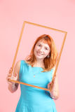 Girl in the frame Stock Photography