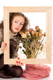 Girl with a frame and a still life Stock Images