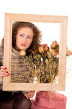 Girl with a frame and still life Stock Photos