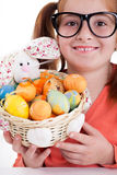 Girl with freckles  and a basket of Easter egg Stock Images