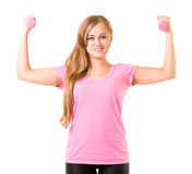 Girl with free weights in gym Stock Images