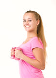 Girl with free weights in gym Stock Photo