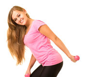 Girl with free weights in gym Stock Photography
