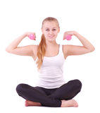 Girl with free weights in gym Royalty Free Stock Photography